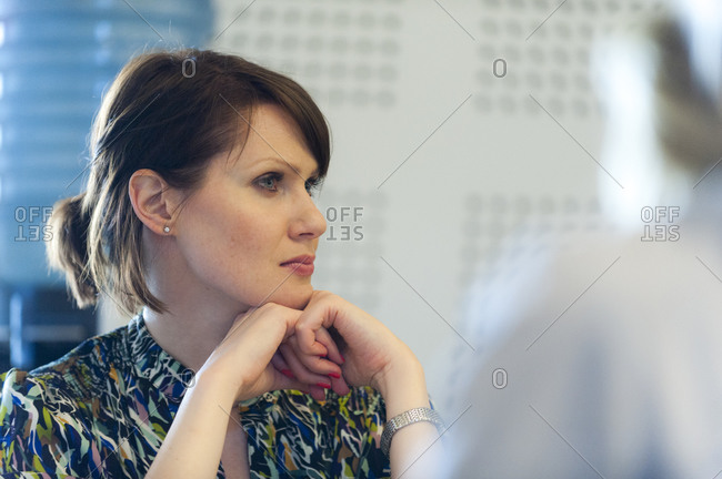 Helsinki, Finland - September 5, 2012: A business student at Aalto University in Helsinki listens to a lecture