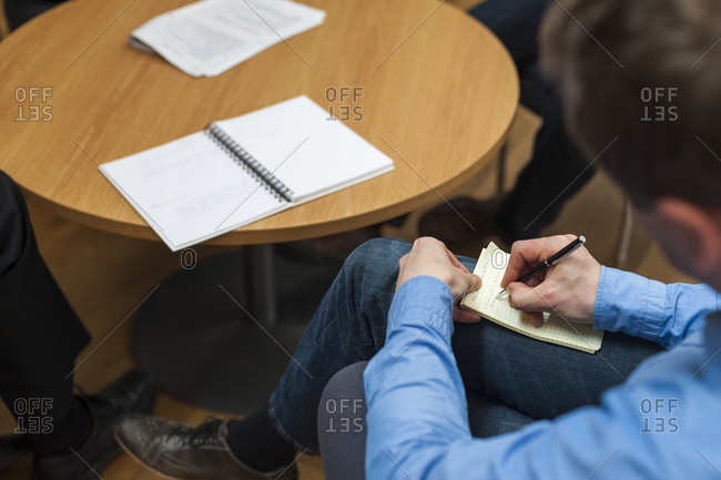 Helsinki, Finland - October 5, 2012: Business students at Aalto University in Helsinki discuss notes in a classroom