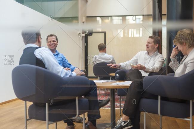 Helsinki, Finland - October 5, 2012: Business students at Aalto University in Helsinki discuss notes