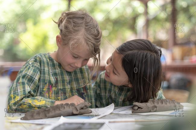 Kathmandu, Nepal - March 4, 2019: Schoolchildren in Kathmandu make a crocodile with modelling clay