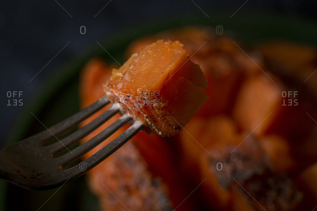 Close up of baked yam on a fork