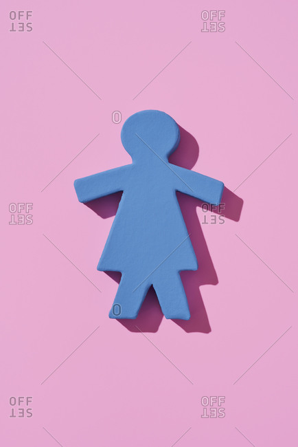 Blue three-dimensional silhouette of a girl or woman on a pink background