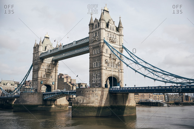 Sightseeing Tower Bridge in London with cloudy sky