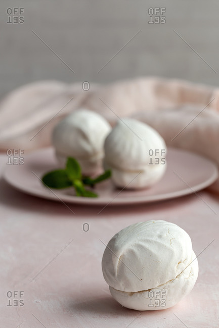 Homemade white Zefir traditional russian dessert with mint on pink background
