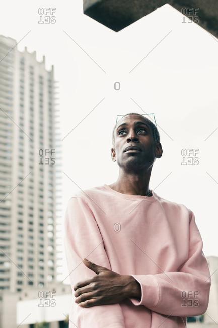 Trendy African American man walking on city street