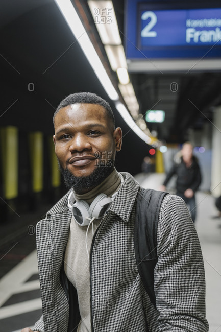 Portrait of stylish man in a metro station