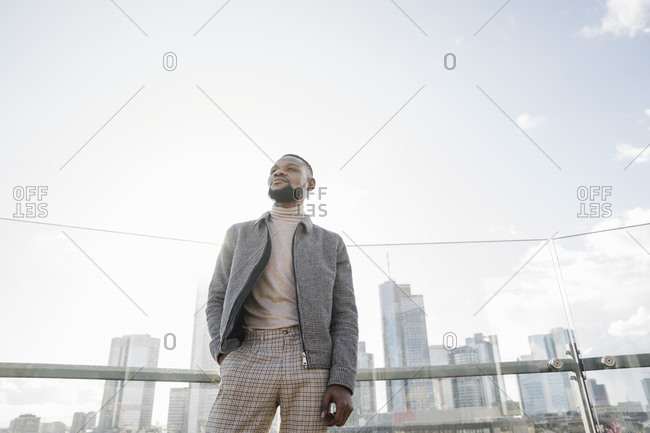 Stylish man standing on observation terrace with skyscraper view- Frankfurt- Germany