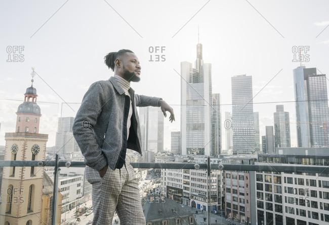 Stylish man on observation terrace looking at skyscraper view- Frankfurt- Germany