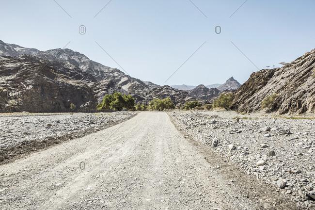 Oman- Ad Dakhiliyah- Empty dirt road in Wadi Bani Awf gorge