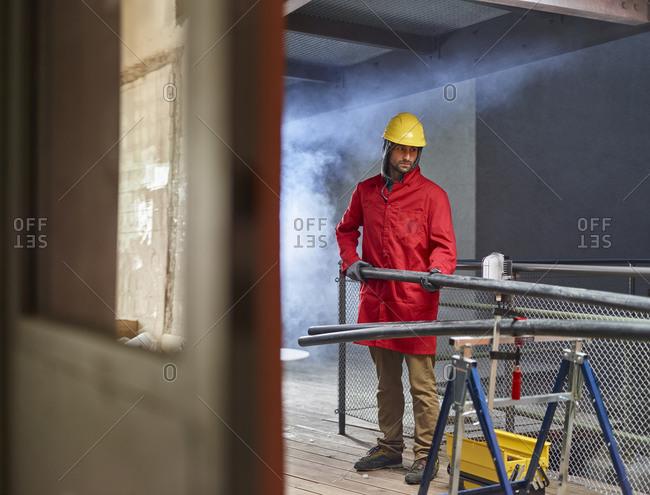 Installer preparing plastic pipes on construction  site