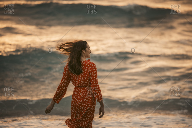 Woman at the seafront at sunrise- Miami- Florida- USA