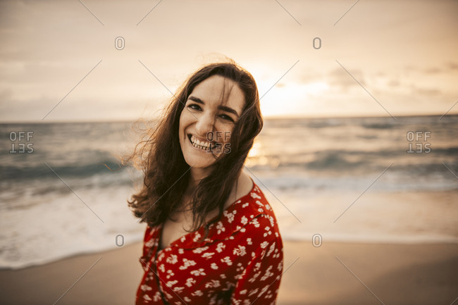 Portrait of happy woman at the seafront at sunrise- Miami- Florida- USA