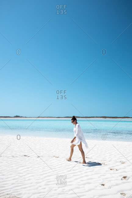Woman walking on white sand bank in the sea- Bahamas- Caribbean