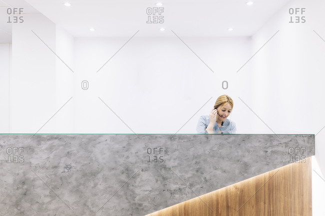 Receptionist with headset at reception desk of a medical practice
