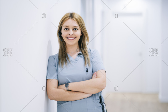 Portrait of smiling medical secretary with headset in medical practice