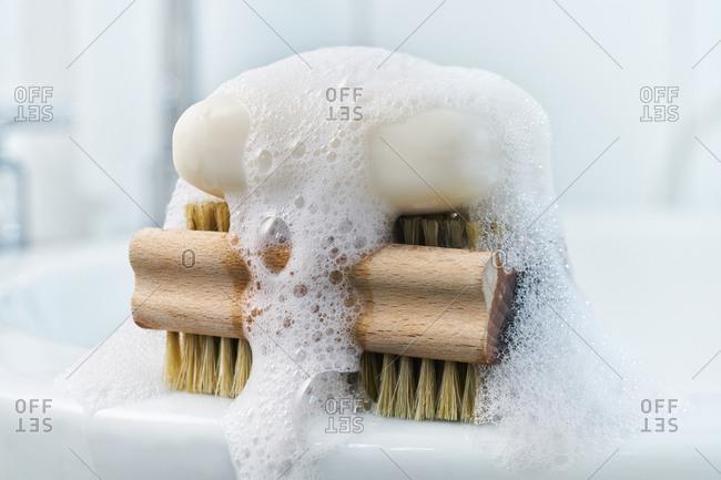 Soap- foam and brush on bathroom sink