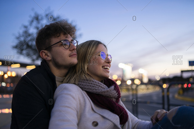 Young couple in love at evening twilight