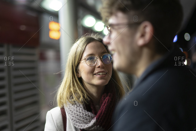 Portrait of smiling young woman looking at her boyfriend