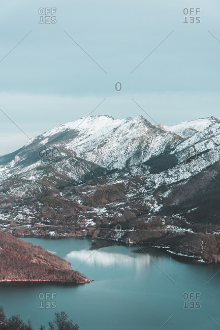 View to snow-covered mountains and lake- Leon Province- Spain
