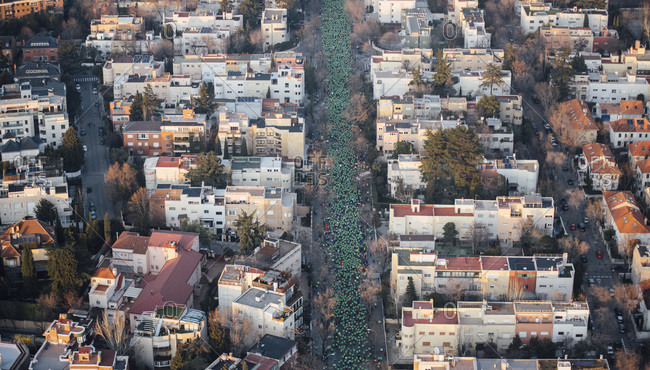 Spain- Madrid- Helicopter view of crowd of people participating in San Silvestre Vallecana marathon
