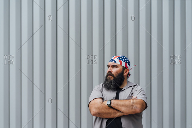 Portrait of bearded man wearing Star and Stripes headgear looking at distance