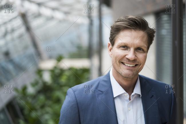 Portrait of a successful- smiling businessman