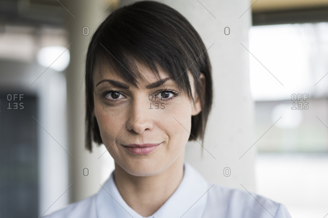 Close up portrait of serene businesswoman