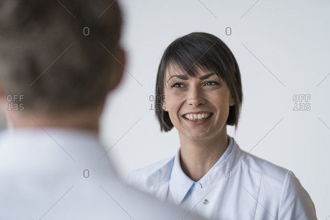 Patient consulting with female doctor