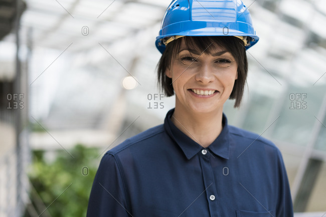 Female architect wearing blue hard hat- portrait