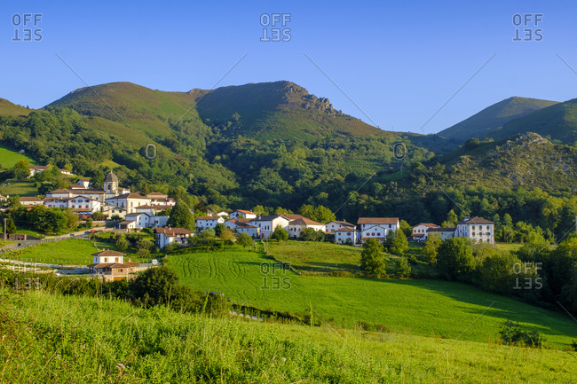 September 12, 2019: Spain- Navarre- Zugarramurdi- Village at foot of green forested hills