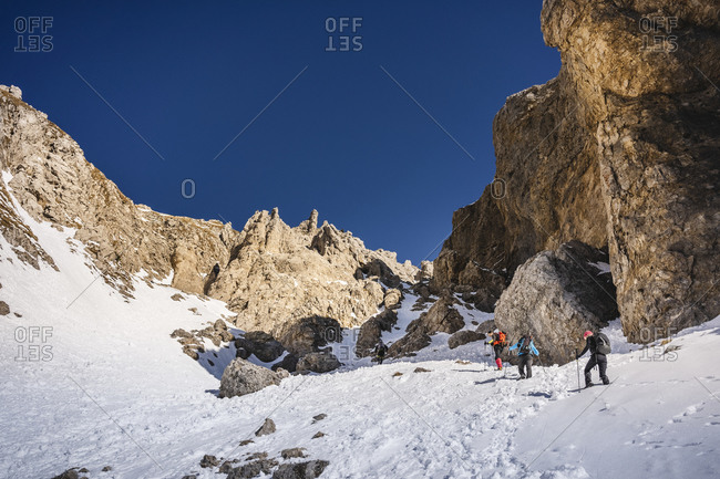 Group of mountaineers climbing a gully- Orobie Alps- Lecco- Italy