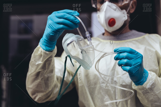 Healthcare worker holding  respiratory mask for ventilators