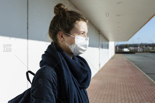 Portrait of woman wearing mask at an empty street