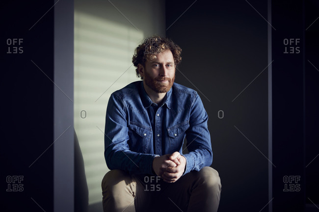 Portrait of a relaxed casual businessman sitting down