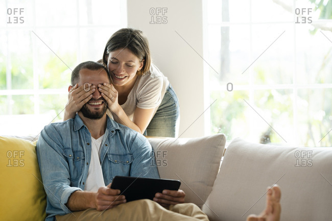 Young couple at home having fun on couch