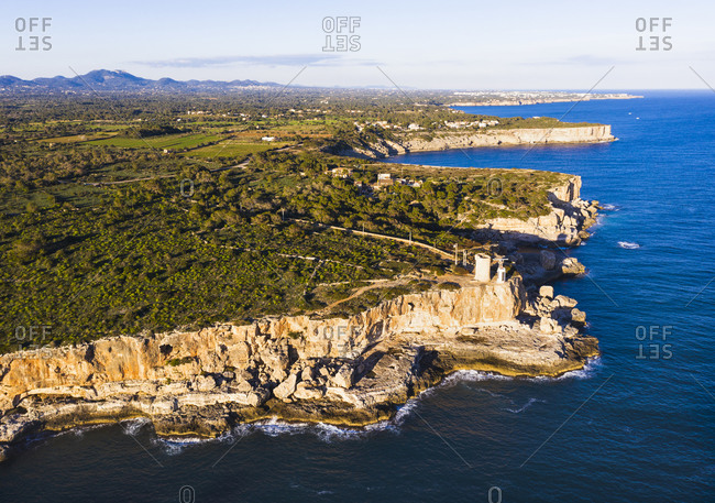 Spain- Balearic Islands- Santanyi- Aerial view of coastal cliffs and Torre den Beu