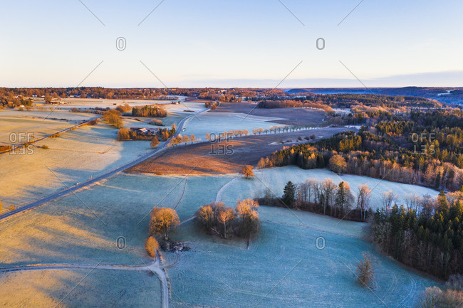 Germany- Bavaria- Icking- Drone view of winter countryside at dawn