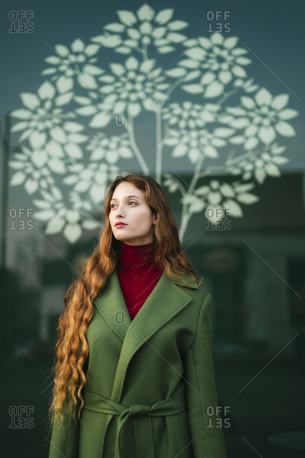 Portrait of redheaded young woman looking at distance