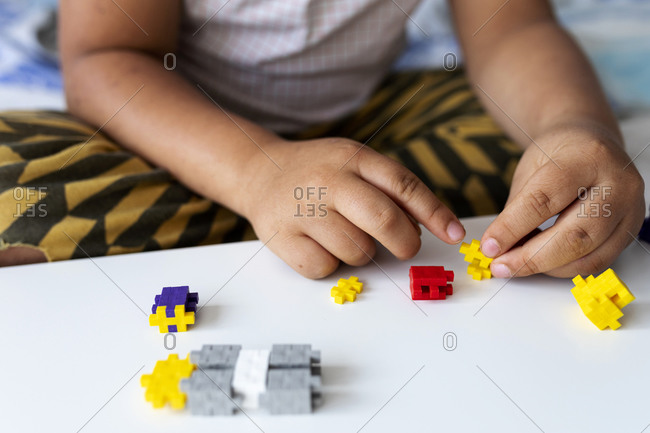 Children's hands playing with building blocks