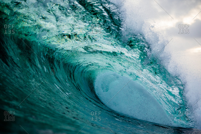 Curling blue wave in the ocean