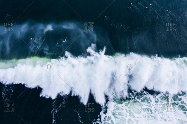 Overhead view of splashing waves in the blue ocean