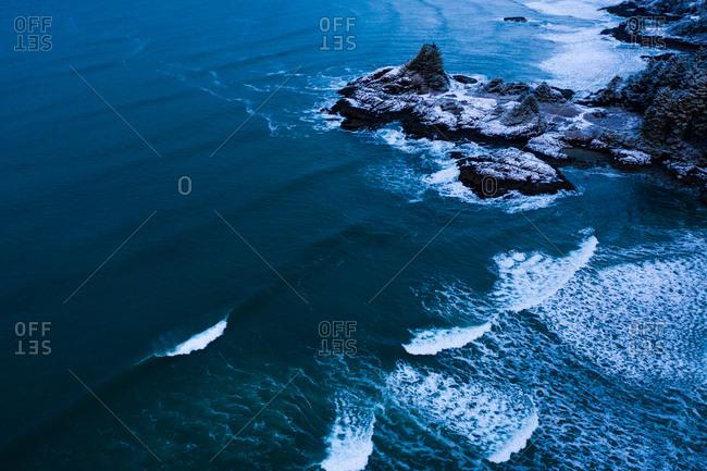 Overhead view of waves in the ocean in wintertime