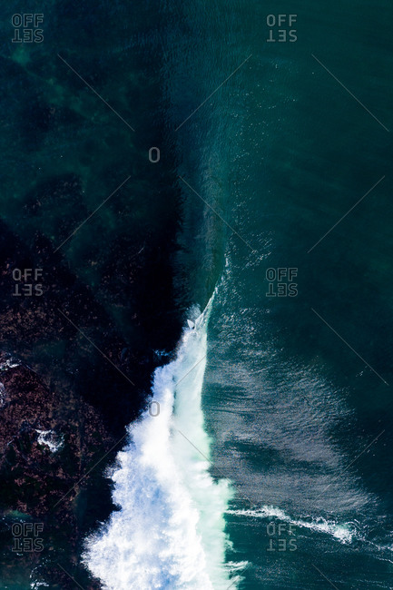 Overhead view of large waves in the blue ocean