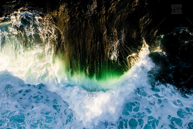 Overhead view of green and blue waves in the blue ocean