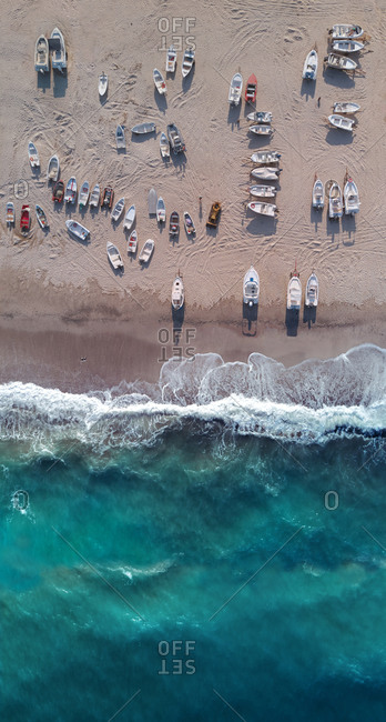 Aerial view of many boats ashore while the sea is rough, San Sostene, Calabria, Italy.