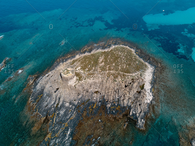 Aerial view of Isola della Pelosa isle and its historic bastion home of a seagulls colony, Stintino, Sardinia, Italy.