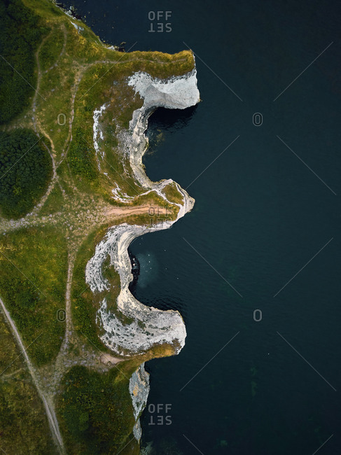 Aerial view of a curious letter-shaped formation along the cliff at Old Harry Rocks, Studland, Dorset, England.