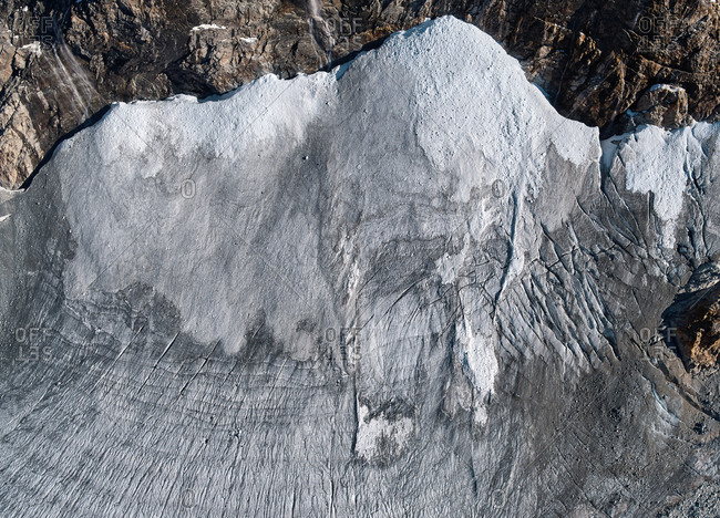 Aerial view of a portion of the Fellaria glacier complex surrounded by the mountain walls, Chiesa in Valmalenco, Lombardy, Italy.