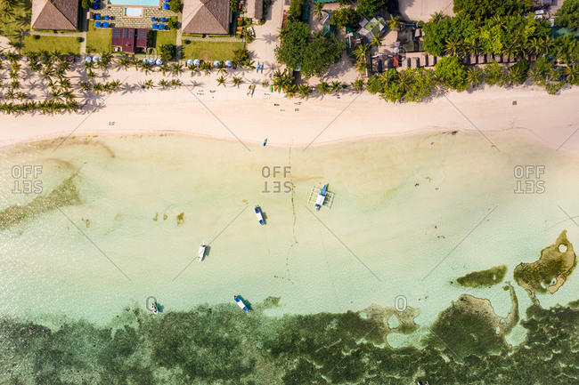 Aerial view of Dumaluan Beach with reef and boats, Panglao, Bohol, Philippines