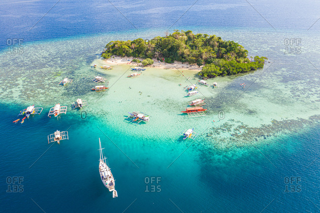 Aerial view of  CYC Beach with Boats in Foreground, Coron, Palawan, Philippines.